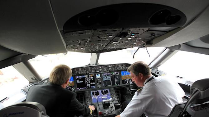 United's pilots Niels Olufsen, left, and Bill Blocker, right, prepare the cockpit while parked at gate E7 at Bush Intercontinental Airport for the first flight back for the Dreamliner, Monday, May 20, 2013, in Houston.  (AP Photo/Houston Chronicle, Karen Warren)