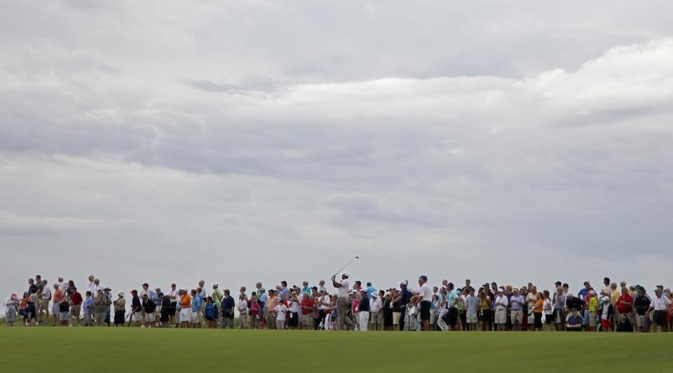 Tiger Woods watches his drive from the 16th tee under stormy sky during a practice round for the PGA Championship golf tournament on the Ocean Course of the Kiawah Island Golf Resort in Kiawah Island, S.C., Wednesday, Aug. 8, 2012. (AP Photo/Chuck Burton)