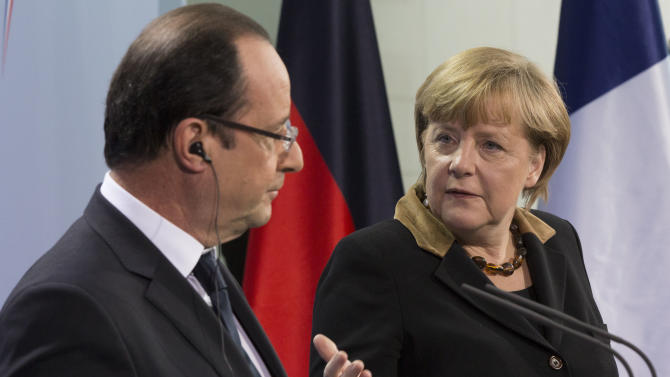 German Chancellor Angela Merkel, right, and French President Francois Hollande, left, hold a joint news conference at the Chancellery in Berlin, Germany, Tuesday, Jan. 22, 2013. France and Germany mark 50 years since they signed the Elysee Treaty, the post-war friendship pact between the former enemies. (AP Photo/Gero Breloer)