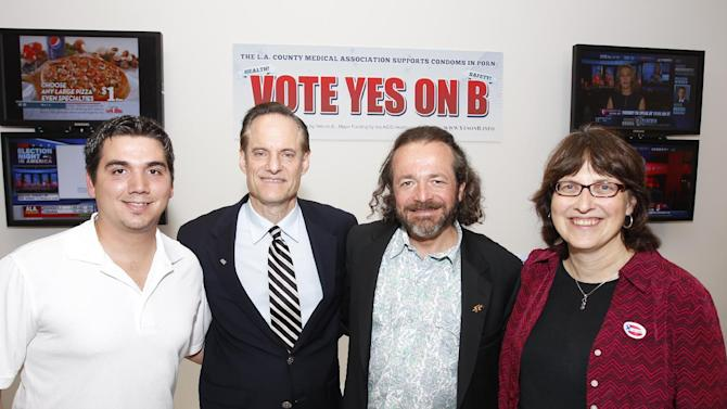 From the left. Former adult film performer Derrick Burts, Michael Weinstein, AIDS Healthcare Foundation, President & Measure B Proponent, Mark McGrath and Dr. Paula Tavrow seen at the AIDS Healthcare Foundation Election Headquarters victory party on Tuesday, November 6, 2012 in Los Angeles, California. (Joe Kohen /AP Images for AIDS Healthcare Foundation) Early results show strong support for Measure B.