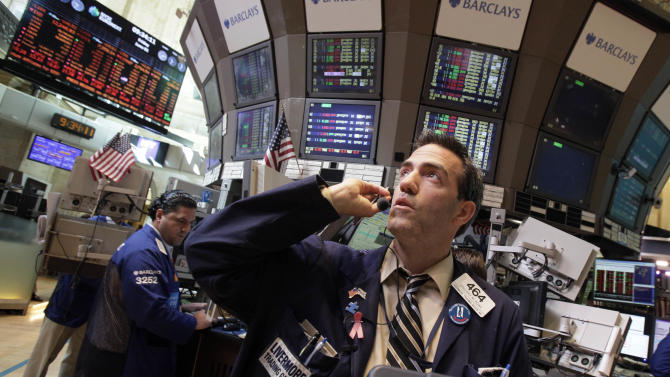 Trader Gregory Rowe works on the floor of the New York Stock Exchange Friday, June 1, 2012. Stocks fell sharply Friday after the release of a dismal report on job creation in the United States. Stocks fell sharply Friday after the release of a dismal report on job creation in the United States. The Dow Jones industrial average dropped more than 200 points, erasing what was left of its gain for the year.  (AP Photo/Richard Drew)