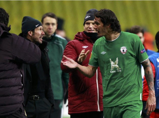 Rubin Kazan's Cesar Navas argues with Atletico Madrid's coach Diego Simeone after their Europa League soccer match at the Luzhniki stadium in Moscow