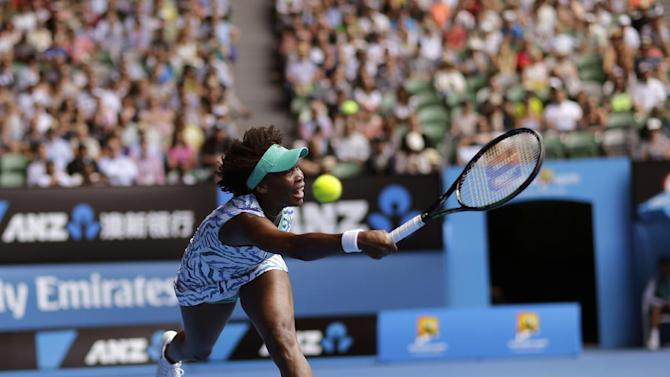 Venus Williams of the U.S. stretches for a return to her compatriot Madison Keys during their quarterfinal match at the Australian Open tennis championship in Melbourne, Australia, Wednesday, Jan. 28, 2015. (AP Photo/Bernat Armangue)