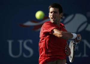 Djokovic of Serbia hits a return to Granollers of Spain at the U.S. Open tennis championships in New York