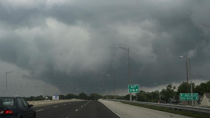 Low-hanging dark crowds are seen northwest on I-65 on Tuesday, June 24, 2014. in Indianapolis. Authorities say a tornado near Indianapolis has damaged at least three homes. National Weather Service meteorologist Mike Ran says the tornado struck Tuesday afternoon just southwest of Indianapolis but was no longer on the ground. (AP Photo/The Indianapolis Star, Charlie Nye ) NO SALES