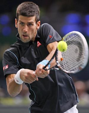 Djokovic beats Isner to reach Paris quarterfinals