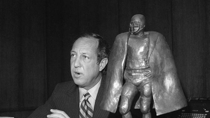 FILE - In this Dec. 27, 1972, file photo National Football League Commissioner Pete Rozelle speaks in his Park Ave., New York, office. Rozelle said no to President Richard Nixon's request to waive the NFL blackout rule on home-game telecasts. (AP Photo/Anthony Camerano, File)
