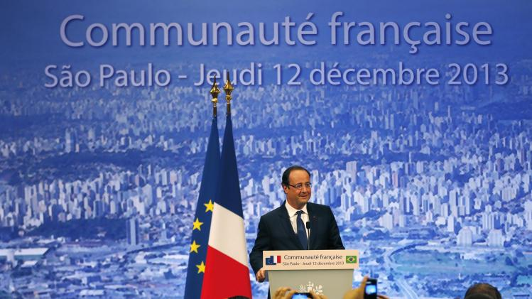 France's President Francois Hollande attends a meeting with the French community in Sao Paulo
