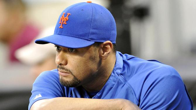 FILE - In this file photo taken Aug. 10, 2012, New York Mets pitcher Johan Santana watches from the dugout a baseball game in New York. Santana is headed to the disabled list and not expected to pitch again this season. General manager Sandy Alderson said Wednesday, Aug. 22, 2012, that the left-hander was going on the 15-day DL with inflammation in his lower back. (AP Photo/Bill Kostroun, file)
