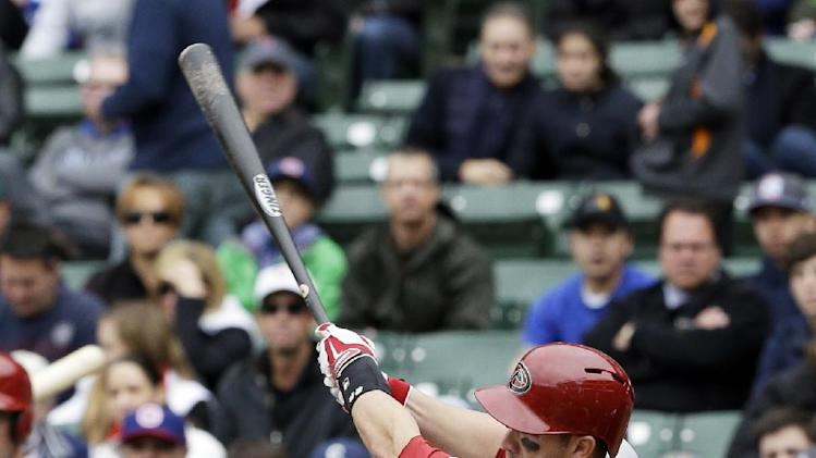 Arizona Diamondbacks' Miguel Montero hits an RBI double against the Chicago Cubs during the first inning of a baseball game in Chicago, Thursday, April 24, 2014