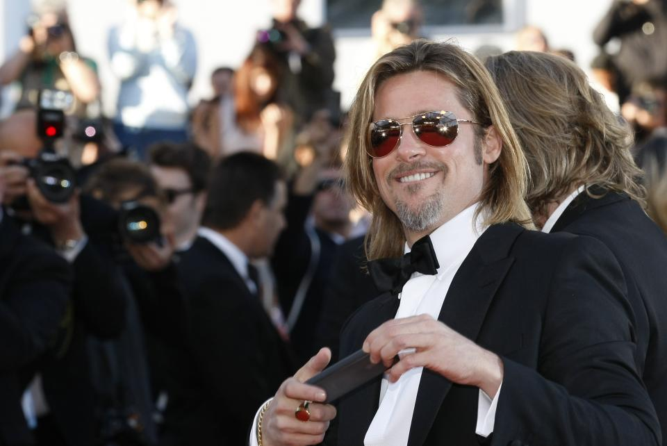 Actor Brad Pitt smiles as he arrives for the screening of Killing Them Softly at the 65th international film festival, in Cannes, southern France, Tuesday, May 22, 2012. (AP Photo/Lionel Cironneau)