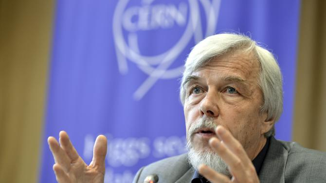 """Rolf Heuer, Director General of CERN (European Organization for Nuclear Research), answers journalist's question about the scientific seminar to deliver the latest update in the search for the Higgs boson at the European Organization for Nuclear Research (CERN) in Meyrin near Geneva, Switzerland, Wednesday, July 4, 2012. The head of the world's biggest atom smasher is claiming discovery of a new particle that he says is consistent with the long-sought Higgs boson known popularly as the """"God particle.""""  Rolf Heuer, director of the European Center for Nuclear Research, or CERN, says """"we have a discovery"""" of a new subatomic particle, a boson, that is """"consistent with a Higgs boson.""""  He spoke after two independent teams at CERN said they have both """"observed"""" a new boson that looks just like the one believed to give all matter in the universe size and shape.  (AP Photo/Keystone/Martial Trezzini)"""