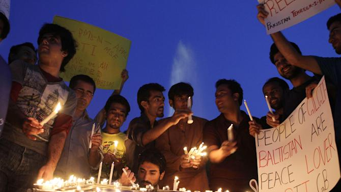 Members of a Civil Society hold candle light vigil in memory of the foreign tourists killed by Islamic militants, Saturday, June 29, 2013, in Lahore, Pakistan. Pakistan's already embattled tourism industry is struggling to deal with worried customers and cancellations after Islamic militants attacked foreign climbers preparing to summit one of the world's tallest mountains, killing many people. (AP Photo/K.M. Chaudary)