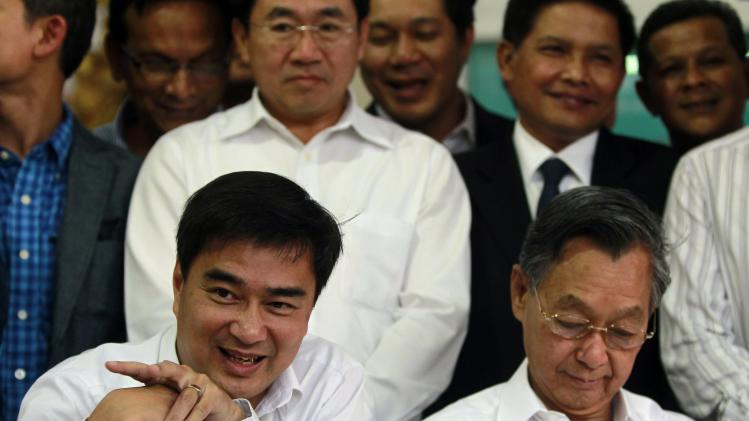 Thailand's opposition leader and former Prime Minister Abhisit Vejjajiva speaks during a news conference as his party members listen at the Democrat Party headquarters in Bangkok