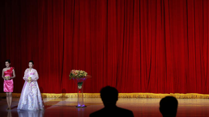 In this Sept. 20, 2012 photo, a North Korean emcee, left, and a translator attend the opening ceremony of 13th Pyongyang film festival in Pyongyang, North Korea.  (AP Photo/Vincent Yu)