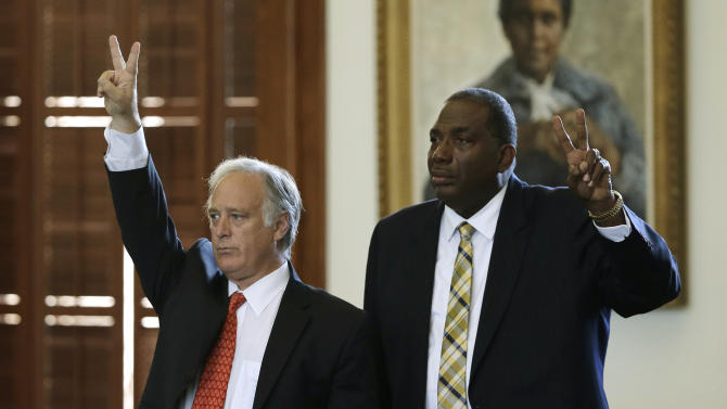 Sen. Kirk Watson, left, D-Austin, and Sen. Royce West, right, D-Dallas, vote against actions that would begin the debate early on legislation sent over by the house, Monday, June 24, 2013, in Austin, Texas. The Republican-dominated Texas Legislature pushed Monday to enact wide-ranging restrictions that would effectively shut down all abortion clinics in the nation's second most-populous state, and Democrats planned an old-fashioned marathon filibuster to stop the final vote. (AP Photo/Eric Gay)