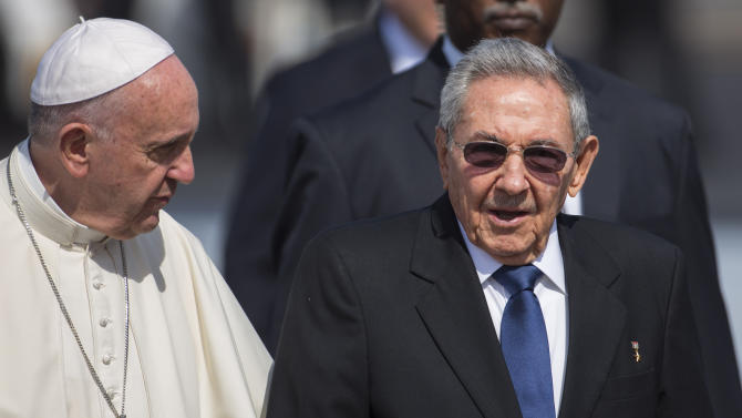 Pope Francis walks next to Cuban President Raul Castro, at the Jose Marti airport in Havana, Cuba, Friday, Feb. 12, 2016. Pope Francis will meet for two hours with the head of the Russian Orthodox Church Patriarch Kirill during a brief stop en route to Mexico.  (AP Photo/Desmond Boylan)