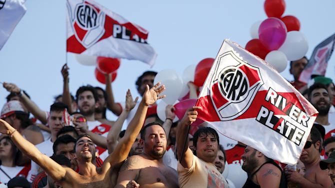 Argentina's River Plate fans cheer before their Copa Libertadores soccer match final against Mexico's Tigres at the Universitario stadium in Monterrey