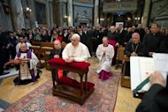 Pope Francis I (C) conducts a mass in Santa Anna church inside the Vatican, in a picture released by Osservatore Romano at the March 17, 2013. REUTERS/Osservatore Romano