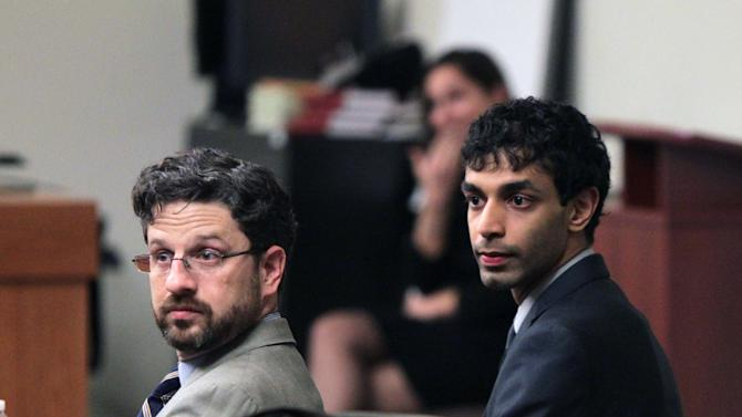 Defense attorney Philip Nettl, left, and Dharun Ravi sit in the courtroom during jury deliberations at the Middlesex County Courthouse, Thursday, March 15, 2012 in New Brunswick, N.J..  Ravi, a former Rutgers University student, faces 15 criminal charges, including invasion of privacy and bias intimidation, a hate crime.  His freshman-year roommate, Tyler Clementi, jumped to his death from the George Washington Bridge in September 2010, just days after Clementi's intimate encounter with another man. (AP Photo/John O'Boyle, Pool)