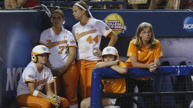 Tennessee co-head coach Karen Weekly, right, and players Kat Dotson, left, Cheyanne Tarango (77) and Madison Shipman (44) watch from the dugout in the sixth inning of the second game of the best of three Women's College World Series NCAA softball championship series in Oklahoma City, Tuesday, June 4, 2013. Oklahoma won the game 4-0 and the best of three series in two games. (AP Photo/Sue Ogrocki)