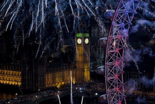 Fireworks light up Big Ben and the London Eye in central London on January 1, 2013