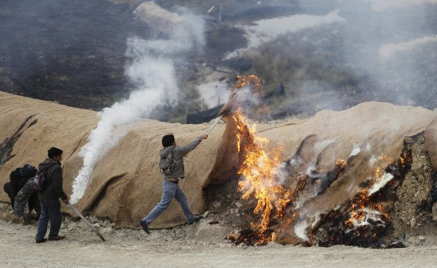 Andean people set fire to areas surrounding a dam, built by Newmont Mining's Conga project, during a protest in Cajamarca