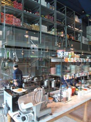 A carefully-designed glass-walled kitchen in the middle of the cafe. (makansutra)