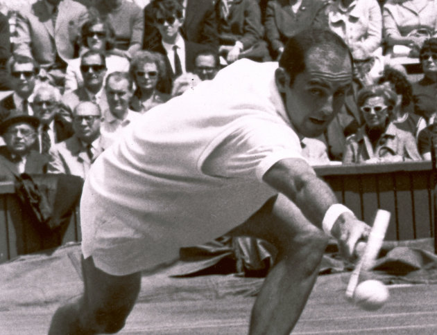 In this June 26, 1965 file photo Bob Hewitt competes during a tennis match at Wimbledon, England. Former Grand Slam doubles champion Bob Hewitt has been served a summons to appear in a South African c