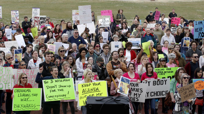 In this Feb. 28, 2012 file photo, people at the state Capitol in Oklahoma City cheer at a rally in opposition to the state Senate's passage of a bill that grants the rights of personhood to fertilized human eggs. An anti-abortion group in Ohio is facing a significant shortfall in the number of signatures needed to ask voters in the presidential battleground this fall whether they want to amend the state's constitution to declare that life begins when a human egg is fertilized. (AP Photo/Sue Ogrocki, File)