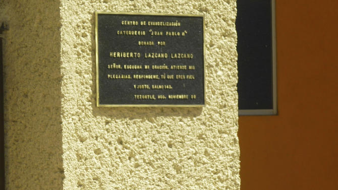 """**  ADDS PHRASE """"THIS PHOTO TAKEN OCT. 20, 2010"""" TO CLARIFY PHOTO DATE  **  This photo taken Oct. 20, 2010 shows a plaque dated Nov. 2009, placed on a wall of a church in the neighborhood of Tezontle, in Pachuca, Mexico. The plaque thanks the major donor who built the church, Heriberto Lazcano Lazcano, the leader of the Zetas, one of Mexico's most violent drug cartels. Plaque reads in Spanish: """"Center for Evangelization and Catechism 'Juan Pablo II', donated by Heriberto Lazcano Lazcano, Lord, hear my prayer, listen to my plea. Answer me because you are faithful and righteous..Psalm 143''. (AP Photo/Victor Valera)"""