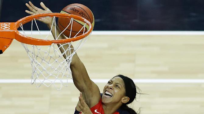 United States' Candace Parker, left, shoots for the basket past Australia's Suzy Batkovic during a women's basketball semifinal game at the 2012 Summer Olympics, Thursday, Aug. 9, 2012, in London. (AP Photo/Victor R. Caivano)