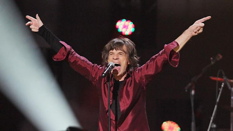 This image released by Starpix shows Mick Jagger of The Rolling Stones performing at the 12-12-12 The Concert for Sandy Relief at Madison Square Garden in New York on Wednesday, Dec. 12, 2012. Proceeds from the show will be distributed through the Robin Hood Foundation. (AP Photo/Starpix, Dave Allocca)