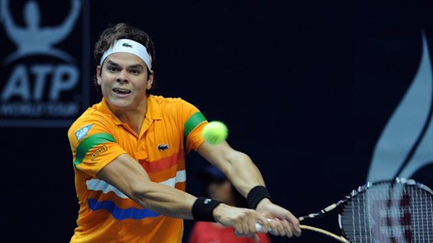 THAILAND, Bangkok : Milos Raonic of Canada plays a shot against Ivo Karlovic of Croatia during their men's singles second round match at the ATP PTT Thailand Open tennis tournament in Bangkok on September 27, 2012.