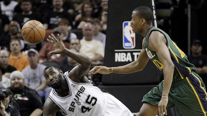 San Antonio Spurs' DeJuan Blair (45) and Utah Jazz's Alec Burks, right, chase a loose ball during the second quarter of Game 2 of a first-round NBA basketball playoff series, Wednesday, May 2, 2012, in San Antonio. (AP Photo/Eric Gay)