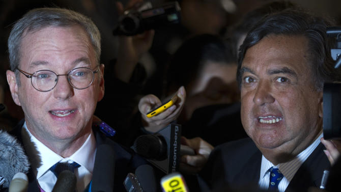 Google executive chairman Eric Schmidt, left, and former New Mexico Gov. Bill Richards, right, brief journalists after they arrived at Beijing Capital International Airport from Pyongyang, in Beijing Thursday, Jan. 10, 2013. Schmidt is urging North Korea to shed its self-imposed isolation and allow its citizens to use the Internet or risk being left behind economically. (AP Photo/Alexander F. Yuan)