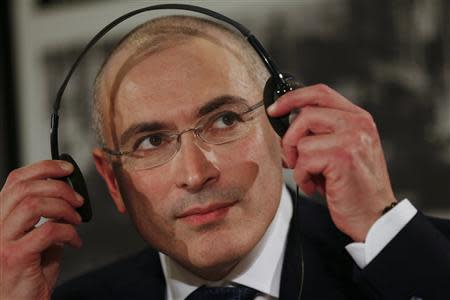 Freed Russian former oil tycoon Khodorkovsky removes headphones at the end of his news conference in the Museum Haus am Checkpoint Charlie in Berlin