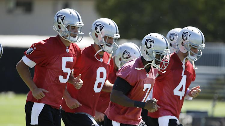From left to right, Oakland Raiders quarterback Trent Edwards, quarterback Matt Schaub, punter Marquette King and quarterback Derek Carr do light sprints during their NFL football training camp on Friday, July 25, 2014, in Napa, Calif. (AP Photo)