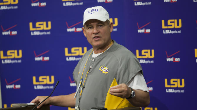 LSU coach Les Miles responds to questions during his weekly news conference at the LSU Football Operations Center Wednesday, Oct. 19, 2011, in Baton Rouge, La. Miles would not speculate on reports of the suspension of LSU football players Tyrann Mathieu, Spencer Ware and Tharold Simon. A person familiar with the decision says No. 1 LSU Mathieu, Simon and Ware for this Saturday's home game against Auburn. The person told The Associated Press about the suspensions on condition of anonymity on Wednesday, Oct. 19, 2011, because they have not been announced. (AP Photo/Tim Mueller)