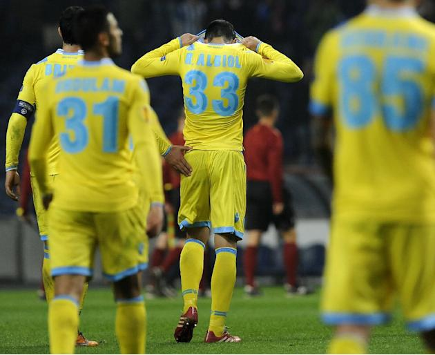 Napoli's Raul Albiol, centre, from Spain reacts after their 1-0 defeat by FC Porto during their Europa League round of 16, first leg soccer match at the Dragao stadium, in Porto, Portugal, Thursda