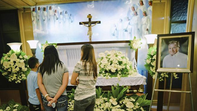 Friends visit the wake of American chemist and Nobel laureate Richard Heck at a funeral parlour in Quezon city, Metro Manila