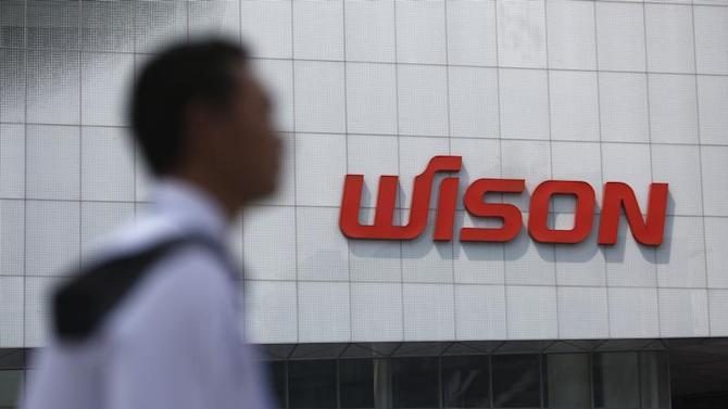 A security guard patrols outside Wison Engineering Services Co Ltd, in Shanghai