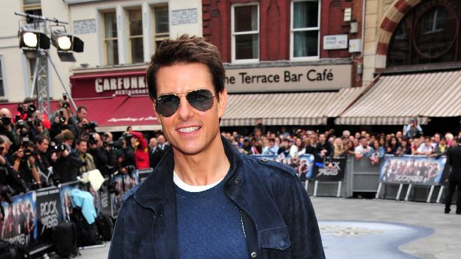 """Tom Cruise arrives at the """"Rock of Ages"""" European premiere at Odeon West End on Sunday June 10, 2012, in London. (Photo by Jon Furniss/Invision/AP)"""