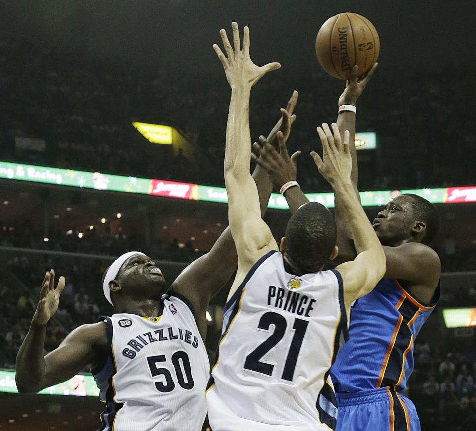 Oklahoma City Thunder's Reggie Jackson, right, shoots against Memphis Grizzlies power forward Zach Randolph (50) and Memphis Grizzlies small forward Tayshaun Prince (21) in the first half of Game 3 in a Western Conference semifinal NBA basketball playoff series in Memphis, Tenn., Saturday, May 11, 2013. (AP Photo/Danny Johnston)