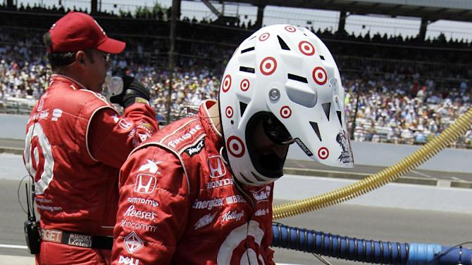 A crewman for Scott Dixon, of New Zealand, attempts to cool off with a fan during IndyCar's Indianapolis 500 auto race at Indianapolis Motor Speedway in Indianapolis, Sunday, May 27, 2012. Temperatures reached the mid 90s, making it the hottest Indy 500 in history. (AP Photo/Darron Cummings)