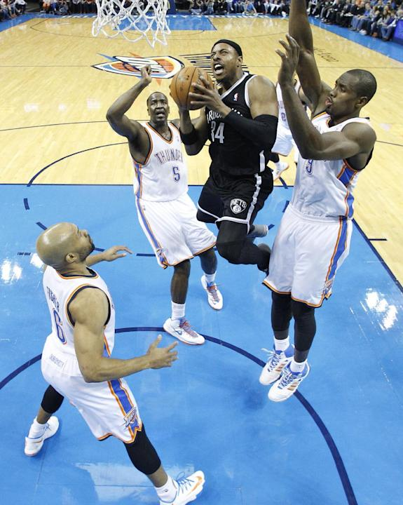 CORRECTS WINNING TEAM - Brooklyn Nets forward Paul Pierce (34) shoots between Oklahoma City Thunder guard Derek Fisher (6), center, Kendrick Perkins (5) and forward Serge Ibaka (9) in the third quarte