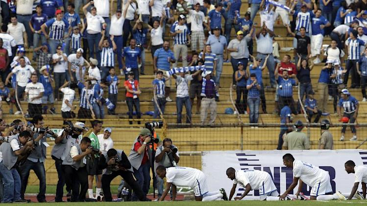 Honduras'Jerry Bengtson, bottom, fourth from right, celebrates with teammates after scoring during a 2014 World Cup qualifying soccer match against U.S. in San Pedro Sula, Honduras, Wednesday Feb. 6, 2013. Honduras won 2-1. (AP Photo/Moises Castillo)