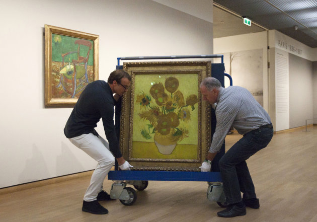Curators are putting Vincent van Gogh&#39;s famous &quot;Sunflowers&quot; painting onto a felt-lined carrier trolley at the Van Gogh Museum in Amsterdam, Netherlands, Sunday, Sept. 23, 2012. While the museum closes for seven months for renovations, 75 works by the Dutch painter will be displayed instead across town at The Hermitage, an Amsterdam satellite of the Russian state museum. The tricky process of transporting the artworks under police escort began immediately after the last visitors left the museum Sunday evening and carried on through the night into Monday morning. The Van Gogh Museum reopens April 25, 2013. (AP Photo/Cris Toala Olivares)