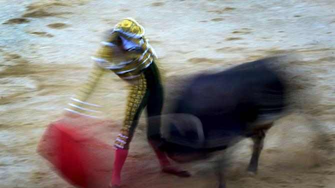 Spanish bullfighter Pepe Moral performs a pass during a bullfight at the San Fermin festival in Pamplona
