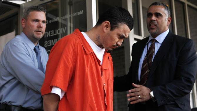 "FILE - In this April 22, 2009 file photo, 27-year-old Ingmar Guandique, center, accused of killing Washington intern Chandra Levy, is escorted from the Violent Crimes Unit in Washington by detectives Tom Williams, left, and Emilio Martinez. Levy vanished April 30, 2001 after completing a federal internship in Washington, and her remains were found in 2002 in a heavily wooded area of Washington's Rock Creek Park. Lawyers for Guandique, who was convicted of killing Levy, said in documents unsealed Tuesday, Feb. 19, 2013 that his prosecution was ""predicated on a lie,"" and they intend to file a motion for a new trial. (AP Photo/Jacquelyn Martin, File)"